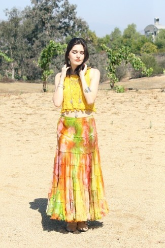 Team a yellow lace cropped top with a multi colored maxi skirt to effortlessly deal with whatever this day throws at you. For the maximum chicness go for a pair of khaki leather chelsea boots.