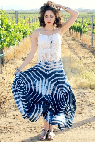 Consider pairing white lace cropped top with a navy and white print maxi skirt for a glam and trendy getup. Rock a pair of silver leather thong sandals for a more relaxed aesthetic.