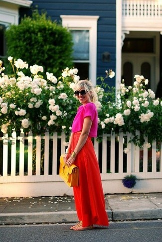 Hot Pink Cropped Top Outfits: This casual combo of a hot pink cropped top and a red maxi skirt takes on different nuances depending on the way you style it. Finishing with a pair of gold leather thong sandals is an easy way to introduce a little edge to your ensemble.