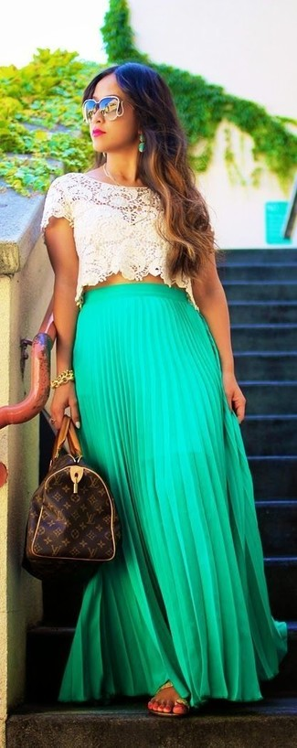 How to wear: beige crochet cropped top, green pleated maxi skirt, tan leather thong sandals, dark brown print leather duffle bag