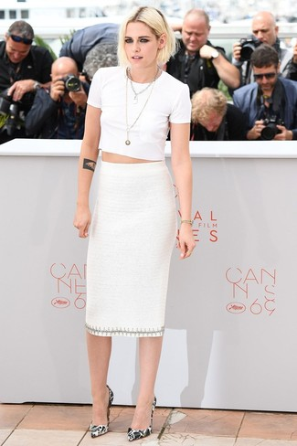 Kristen Stewart wearing White Cropped Top, White Midi Skirt, White and Black Print Leather Pumps, Silver Necklace