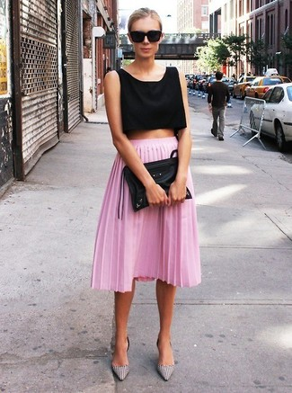 Master the effortlessly chic look in a black cropped top and a pink pleated midi skirt. Why not introduce monochrome gingham leather pumps to the mix for an added touch of style?