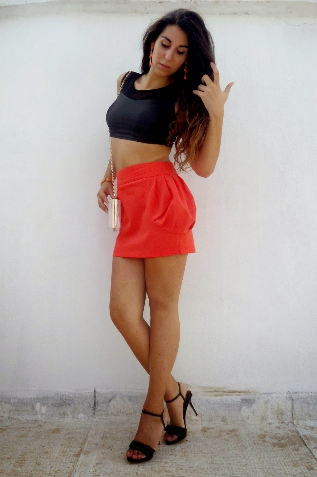 87a2d35e2b21 How to wear: black cropped top, orange mini skirt, black leather heeled  sandals
