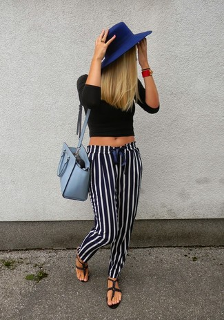 Something as simple as opting for a black cropped top and navy and white striped casual pants can potentially set you apart from the crowd. Make your outfit more fun by rounding off with thong sandals. You know when it's super hot outside, sometimes only a fresh outfit like this one can get you through the day.
