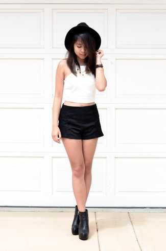 How to wear: white cropped top, black lace shorts, black leather ankle boots, black wool hat