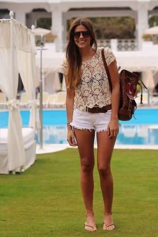 How to wear: beige lace cropped top, white denim shorts, beige leather thong sandals, dark brown leather backpack