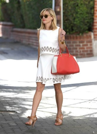 Reese Witherspoon wearing White Eyelet Cropped Top, White Eyelet Skater Skirt, Tan Leather Heeled Sandals, Red Leather Tote Bag