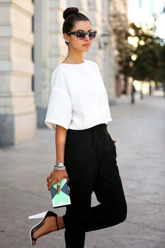Try pairing a white cropped top with black tapered pants to effortlessly deal with whatever this day throws at you. White and black suede heeled sandals will instantly smarten up even the laziest of looks.