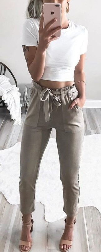 How to wear: white cropped top, beige tapered pants, beige leather heeled sandals, gold bracelet