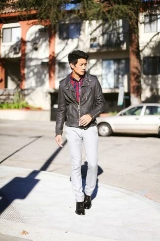 How to wear: dark brown leather biker jacket, red and navy plaid long sleeve shirt, grey chinos, dark brown leather brogues