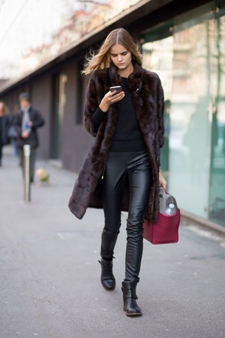 How to wear: dark brown fur coat, black crew-neck sweater, black leather skinny pants, black leather ankle boots