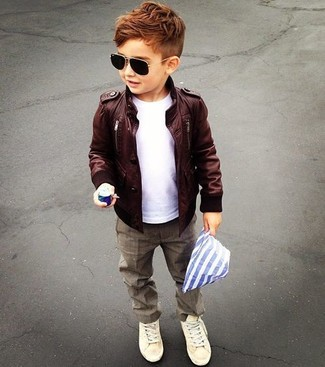 How to Wear Brown Trousers For Boys: You'll have no problem tempting your munchkin into wearing this combo of a dark brown leather jacket and brown trousers. Beige sneakers are a smart choice to complement this outfit.