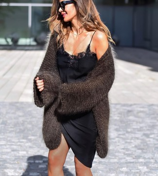 How to wear: dark brown knit open cardigan, black satin cami dress, black sunglasses