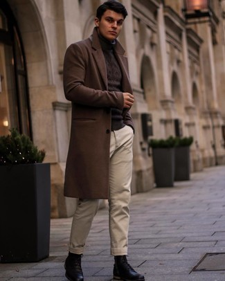 1200+ Cold Weather Outfits For Men: A dark brown overcoat and beige chinos are absolute wardrobe heroes if you're crafting a sophisticated closet that matches up to the highest menswear standards. When it comes to shoes, this ensemble is rounded off well with black leather casual boots.