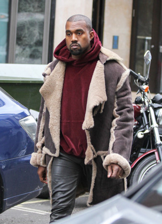 How to wear: dark brown shearling jacket, burgundy velvet hoodie, black leather jeans