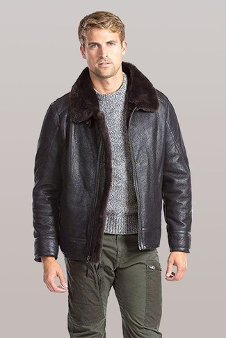 How to wear: dark brown shearling jacket, grey crew-neck sweater, olive cargo pants