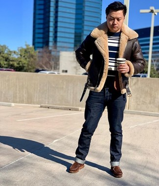 How to wear: dark brown shearling jacket, navy and white horizontal striped crew-neck sweater, navy jeans, brown leather work boots