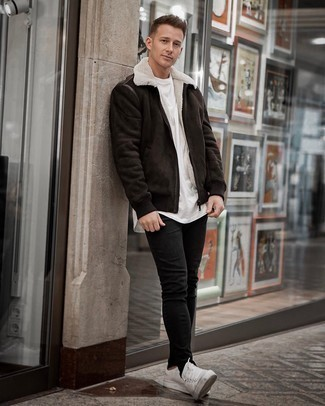 White and Red Leather Low Top Sneakers Outfits For Men: If you're hunting for a casual and at the same time stylish outfit, consider teaming a dark brown shearling jacket with black skinny jeans. Add white and red leather low top sneakers to your ensemble and the whole outfit will come together quite nicely.