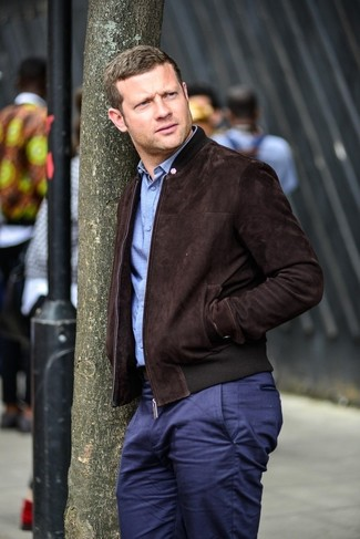 Dermot O'Leary wearing Dark Brown Suede Bomber Jacket, Light Blue Long Sleeve Shirt, Navy Chinos
