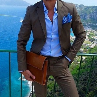 How to wear: dark brown suit, blue dress shirt, tobacco leather zip pouch, blue pocket square