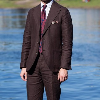 How to wear: dark brown suit, white dress shirt, red and navy print tie, beige print pocket square