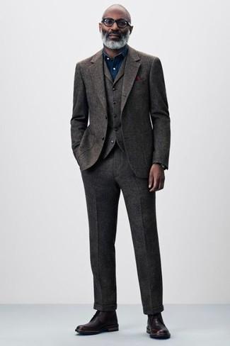 How to wear: dark brown wool three piece suit, navy chambray dress shirt, burgundy leather dress boots, burgundy pocket square