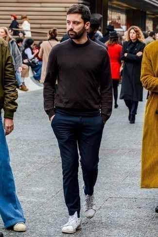 Men's Looks & Outfits: What To Wear In 2020: A dark brown turtleneck and navy wool chinos are a favorite combo for many trendsetting men. A pair of white leather low top sneakers adds more depth to an otherwise all-too-safe look.