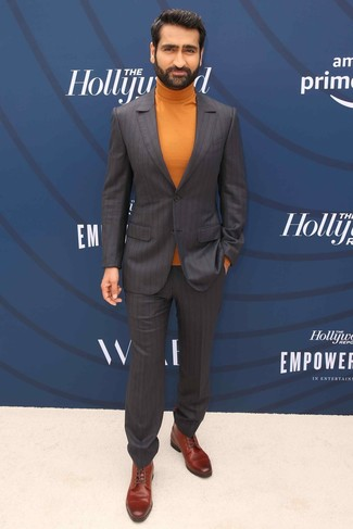 Kumail Nanjiani wearing Dark Brown Vertical Striped Suit, Orange Turtleneck, Brown Leather Dress Boots