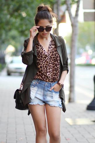 How to wear: dark green anorak, tan leopard long sleeve blouse, light blue ripped denim shorts, black leather crossbody bag