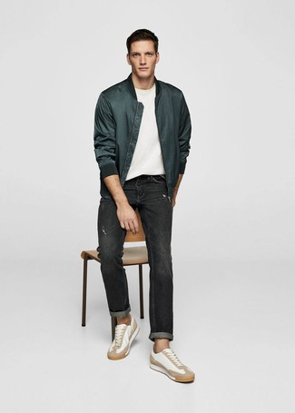 How to Wear White Leather Low Top Sneakers For Men: A dark green satin bomber jacket and black jeans worn together are the perfect combination for those who love laid-back styles. A pair of white leather low top sneakers complements this getup very nicely.