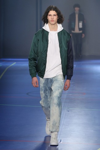 How to wear: dark green bomber jacket, white hoodie, light blue acid jeans, white high top sneakers