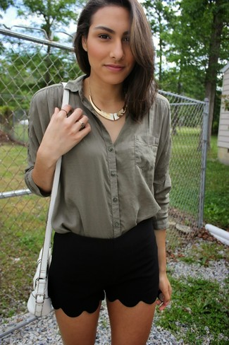 Dress in a dark green button down blouse and black shorts for a standout ensemble.
