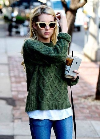 A hunter green cable sweater and blue skinny jeans is a savvy combination to carry you throughout the day.