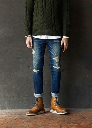 How to Wear Blue Ripped Skinny Jeans For Men: A dark green cable sweater and blue ripped skinny jeans are a bold casual combo that every stylish man should have in his casual fashion mix. For a more polished finish, complement this getup with tobacco leather brogue boots.