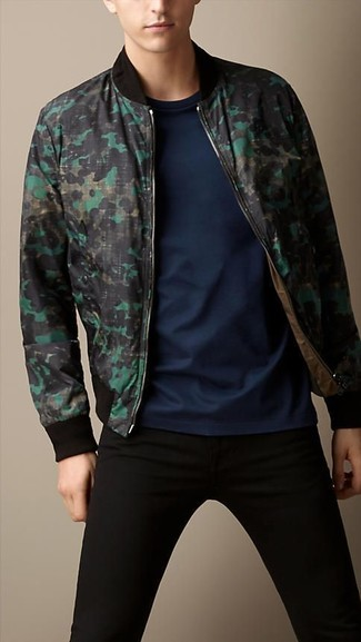 For an everyday outfit that is full of character and personality consider teaming a dark green camo bomber jacket with black slim jeans. These picks will keep you cozy and stylish in unpredictable fall weather.