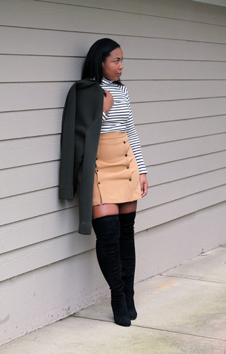 If you feel more confident wearing something comfortable, you'll love this absolutely chic combination of a hunter green coat and a button skirt. Black suede over the knee boots are a smart choice to round off the look. We're loving how this combination gets you excited for fall in seconds time.