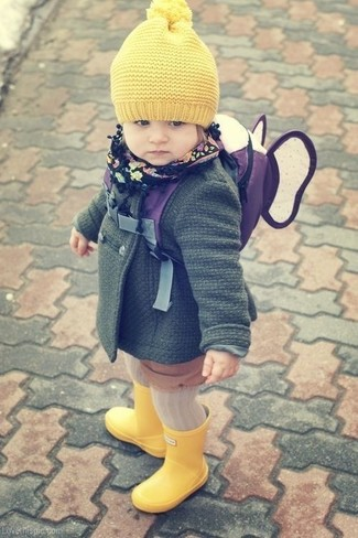 Opting for a dark green coat will surely set your tot apart from the kid crowd. A pair of yellow rain boots will seamlessly integrate within a variety of outfits.