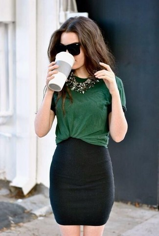 Busy days call for a simple yet stylish outfit, such as a hunter green crew-neck tee and a skirt.