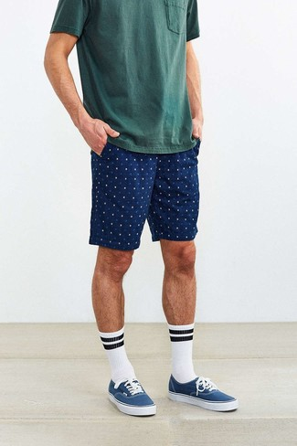 How to Wear Blue Sneakers For Men: For an ensemble that's pared-down but can be styled in many different ways, team a dark green crew-neck t-shirt with navy print shorts. And if you need to instantly dress down this outfit with footwear, complement this outfit with a pair of blue sneakers.