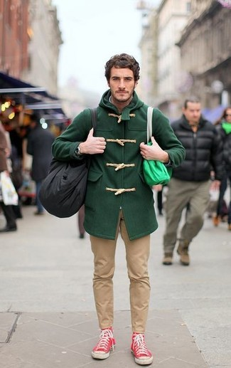 Pair a dark green duffel coat with khaki chinos for a seriously stylish look. For a more relaxed take, grab a pair of red high top sneakers.
