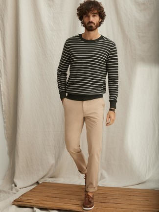 How to Wear Boat Shoes: If you enjoy a more relaxed approach to style, why not wear a dark green horizontal striped crew-neck sweater with khaki chinos? When it comes to footwear, this ensemble pairs perfectly with boat shoes.