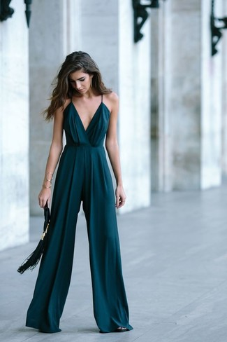 How to wear: dark green jumpsuit, black leather heeled sandals, black fringe suede clutch