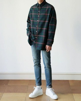 How to Wear Blue Skinny Jeans For Men: You're looking at the solid proof that a dark green plaid long sleeve shirt and blue skinny jeans look awesome when paired together in a relaxed look. Here's how to infuse an added touch of refinement into this look: white leather low top sneakers.