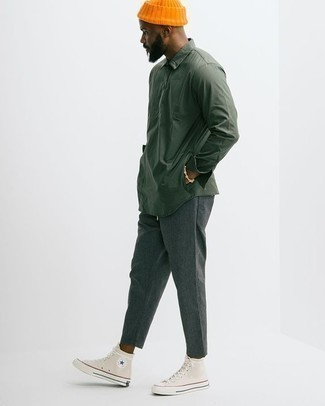 How to Wear Charcoal Chinos: This combo of a dark green long sleeve shirt and charcoal chinos combines comfort and confidence and helps you keep it clean yet contemporary. Finishing with a pair of beige canvas high top sneakers is an effortless way to add a sense of stylish nonchalance to your outfit.