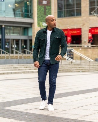 Navy Jeans Outfits For Men: This combination of a dark green corduroy long sleeve shirt and navy jeans is outrageously stylish and yet it's laid-back enough and ready for anything. White leather low top sneakers are a wonderful pick to complete this getup.