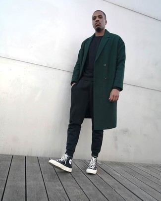 Track Suit Outfits For Men: If you prefer laid-back style, why not take this combo of a track suit and a dark green overcoat for a spin? Black and white canvas high top sneakers bring a more dressed-down aesthetic to the look.