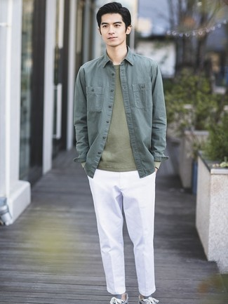 How to Wear an Olive Crew-neck Sweater For Men: Combining an olive crew-neck sweater with white chinos is a smart idea for a laid-back and cool getup. Feeling inventive today? Dial down this outfit by rocking grey low top sneakers.