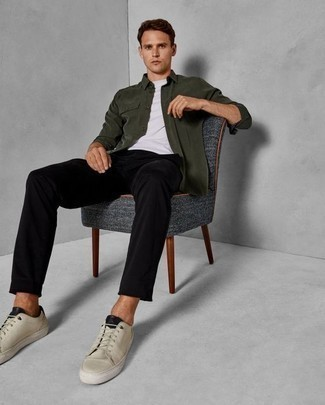 How to Wear Beige Low Top Sneakers For Men: This smart pairing of a dark green shirt jacket and black chinos is super easy to put together in no time flat, helping you look sharp and prepared for anything without spending too much time combing through your wardrobe. Get a bit experimental with footwear and dial down this getup by finishing off with a pair of beige low top sneakers.