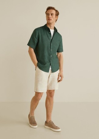 How to Wear Tan Suede Low Top Sneakers For Men: You're looking at the solid proof that a dark green short sleeve shirt and white shorts look awesome together in a casual outfit. Tan suede low top sneakers look wonderful rounding off this outfit.