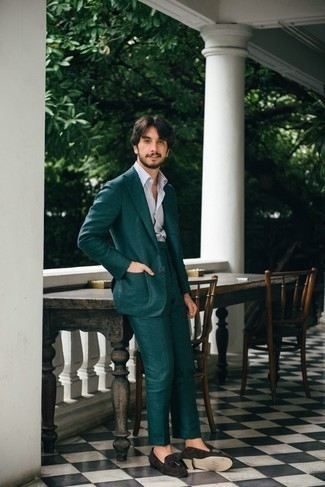 Men's Outfits 2020: This pairing of a dark green suit and a white vertical striped dress shirt couldn't possibly come across other than devastatingly sharp and polished. Dark brown suede tassel loafers complete this look quite nicely.